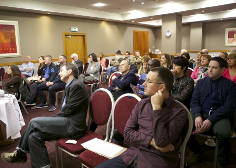 Audience listens to Alan McCully's Address