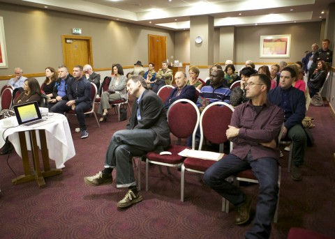 Audience listens to Collette Nulty's Address